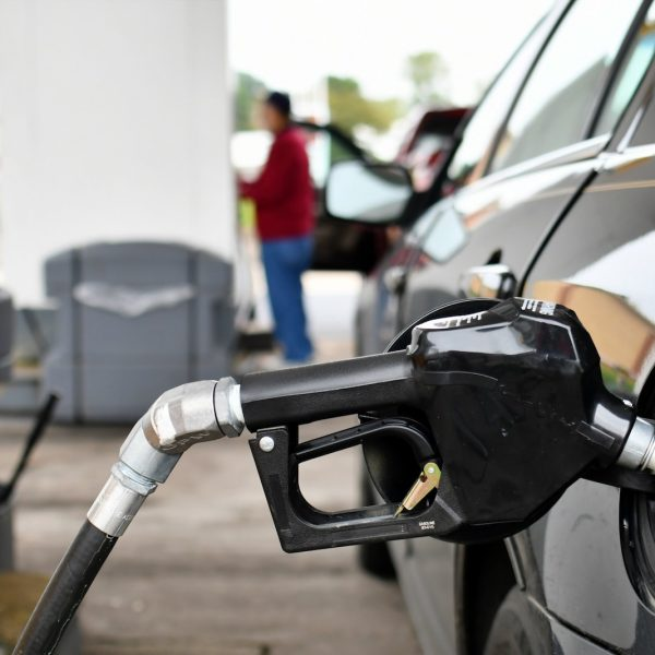 pumping-gasoline-into-a-gas-tank-at-a-filling-station-putting-gas-in-your-car-truck-or-other-vehicle_t20_godQzx.jpg
